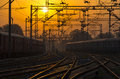 Train railroad railway tracks at major train station at sunset sunrise silhouette of a Royalty Free Stock Photos
