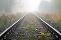 Train rails in foggy weather Royalty Free Stock Photo