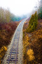 Train rails in landscape the of a that run a canadian winter vertical photo sky with fog at the top location outskirts of toronto Stock Image