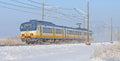 Train Riding Through A Snowy L...