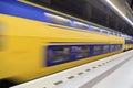 Train rushing by doubledecker past underground trains station platform Stock Image