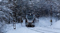 Train speeding in a snowy winter night Royalty Free Stock Photo