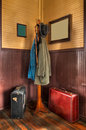 Train Station Coat Rack & Luggage in Corner Royalty Free Stock Photo