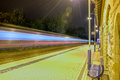 Train station going fast at in night Stock Image