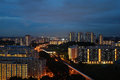 Train station government housing in singapore with light up under an evening skies local people called the building hdb Royalty Free Stock Image