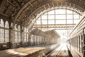 Train station indoor sunset sunrise in sepia. Carriage and platform with construction roof Royalty Free Stock Photo