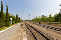 Train station long railway line leading to the distance destination Stock Photos