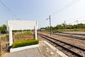 Train station long railway line leading to the distance destination Royalty Free Stock Photography