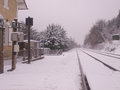 Train station with rail track covered by snow on winter on perigueax french district Stock Photography