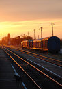 Train at sunset station lights Royalty Free Stock Photo