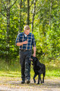 Train to heel dog owner trains his labrador retriever Stock Photos