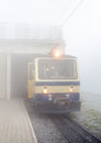 Train to the top of rocher de naye in a fog at switzerland Royalty Free Stock Photo