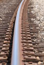 Train track one single in gravel with a curve Royalty Free Stock Images