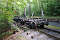 A train track from pioneer logging days rail running through forest to transport forestry products to and mobile saw mill Stock Photo