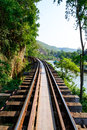 Train track with river and mountain view in thailand railway Royalty Free Stock Photos