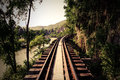 Train track with river and mountain view in thailand railway vintage style Stock Images