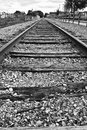 Train track to nowhere old obsolete tracks out of service run the horizon empty Stock Image