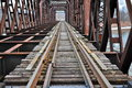 Train tracks a bridge with on a cold winter day Royalty Free Stock Image