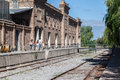 Train tracks mendoza argentina next to a winery historical brick building Royalty Free Stock Image