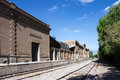 Train tracks mendoza next to a winery historical brick building argentina Stock Photos