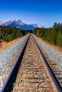 Train tracks railway line running through banff national park alberta canada Royalty Free Stock Photo