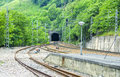 Train tracks routes in nature with the entrance of a tunnel Stock Photography