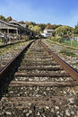 Train tracks a view of as they approach a depot seen in the quaint village of watkins glen new york Royalty Free Stock Images