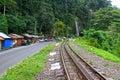 TRAIN TRACKS & WATERFALL IN SUMATRA Royalty Free Stock Photo