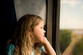 Train travel adorable young girl daydreaming while riding the Stock Image
