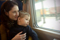 Train travel mother holding child in her arms during Stock Photos