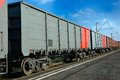 Train wagons of for transportation of goods on blue sky background Royalty Free Stock Image
