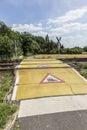 Train warning sign at a railroad crossing Royalty Free Stock Photo