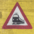 Train warning sign at a railroad crossing Royalty Free Stock Photo