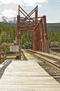 Train and wooden railroad trestle Royalty Free Stock Photo