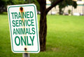 Trained service animals only sign at park in summer summertime Stock Photo