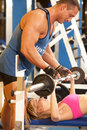 Trainer assisting woman at gym Royalty Free Stock Photo