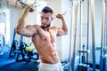 Trainer bodybuilder working out the biceps and the abs in gym on a daily workout routine Stock Photography