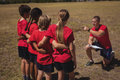 Trainer instructing kids in the boot camp Royalty Free Stock Photo