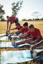 Trainer instructing kids while exercising in the boot camp Royalty Free Stock Photo