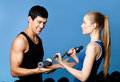 Trainer shows woman the correct exercise performing Stock Photo