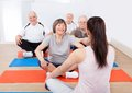Trainer training customers in yoga class Royalty Free Stock Photo