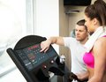 image photo : Trainer and woman in fitness club