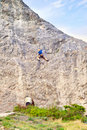 Training of alpinist sportsman an climbing on a cliff Stock Images