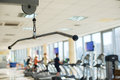 Training apparatus in gym hall picture of with people exercising on background Stock Photo