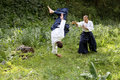 Training martial art aikido on nature outdoors summer day Stock Photo