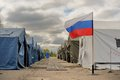 Training refugees camp of russian emergency control ministry in orel with flag and cloudy sky horizontal Stock Photos
