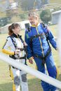 Trainne and teacher skydivers getting in plane Royalty Free Stock Photo