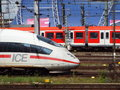 Trains at cologne main station germany entering and exiting Stock Image