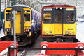 Trains in glasgow central station scotland class dmu diesel multiple unit and class emu electric multiple unit at the buffers Stock Photography