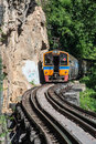 Trains running on death railways track crossing kwai river in kanchanaburi thailand this important destination of world Royalty Free Stock Image